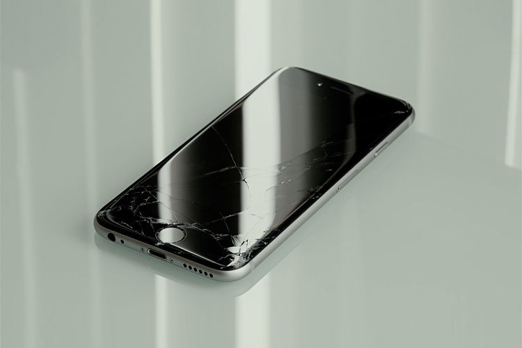 iPhone with broken screen. Broken Broken Glass Broken Iphone Broken Phone Broken Screen Cellphone Close-up Contrast Cracked Cracks Day Display Dropped Gadget Glass - Material Indoors  IPhone Minimalism No People Reflection Repair Repairs Screen Shattered Smartphone