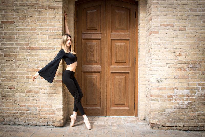 Full length of woman standing by door