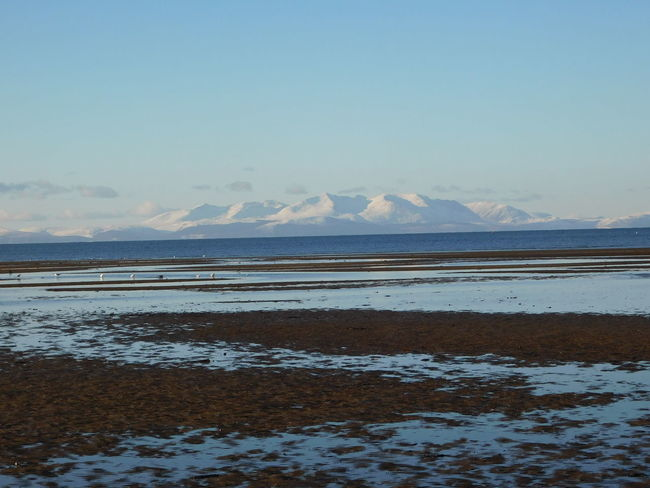The stunning coastline of the Firth of Clyde looking towards a snow covered Isle of Arran. Arran  Ayrshire, Scotland Beautiful South Beach Beauty In Nature Day Landscape Nature No People Outdoors Salt - Mineral Sand Scenics Sea Shoreline Sky Snow Tranquil Scene Tranquility Troon Water