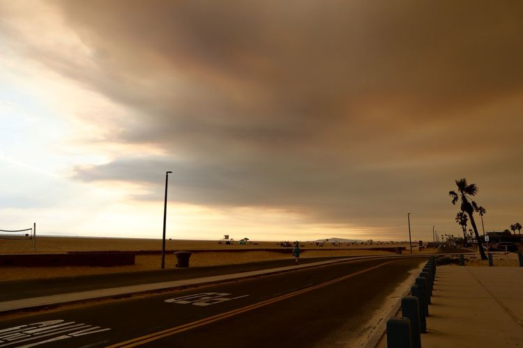 smoke filled sky over Huntington Beach from a California wildfire Dark Sky Holy Fire Huntington Beach CA Arson  Holy Jim Fire Natural Disaster Pollution Smoke Filled Sky Southern California Beach Wildfire
