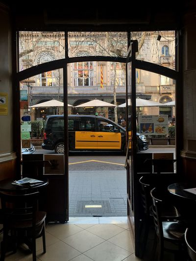 Les Rambles Las Ramblas Barcelona Taxi Vehicle Taxi Indoors  Transportation Window Restaurant Table Mode Of Transport Chair Architecture