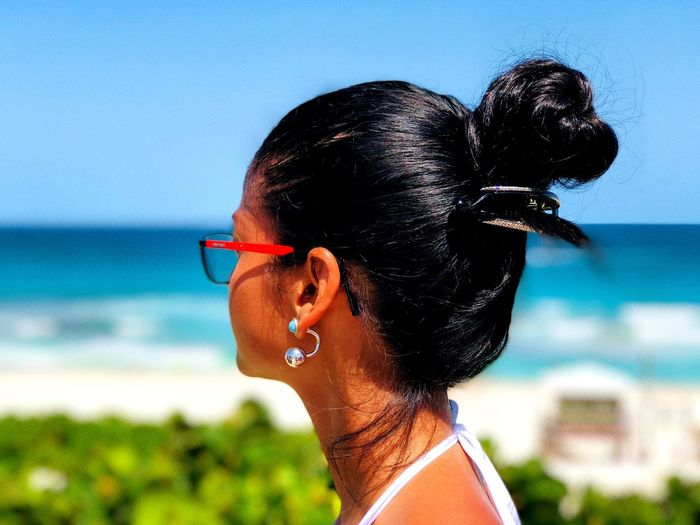 Cancún EyeEmNewHere EyeEm Best Shots Vacations Beachphotography Beach Sea Peace Women Girl Latina Crazy Love Headshot One Person Portrait Sea Close-up Lifestyles Glasses Day Outdoors Profile View Water Real People Nature Sky Fashion Sunlight Land