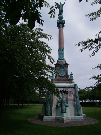 Monument, Den Lille Havfrue Area Built Structure Cannons Capital City Composition Copenhagen Den Lille Havfrue Denmark Famous Place Full Frame Grey Sky History Human Representation International Landmark Lawn Memorial Monument No People Outdoor Photography Statue Tourism Tourist Attraction  Travel Destinations Trees War Memorial