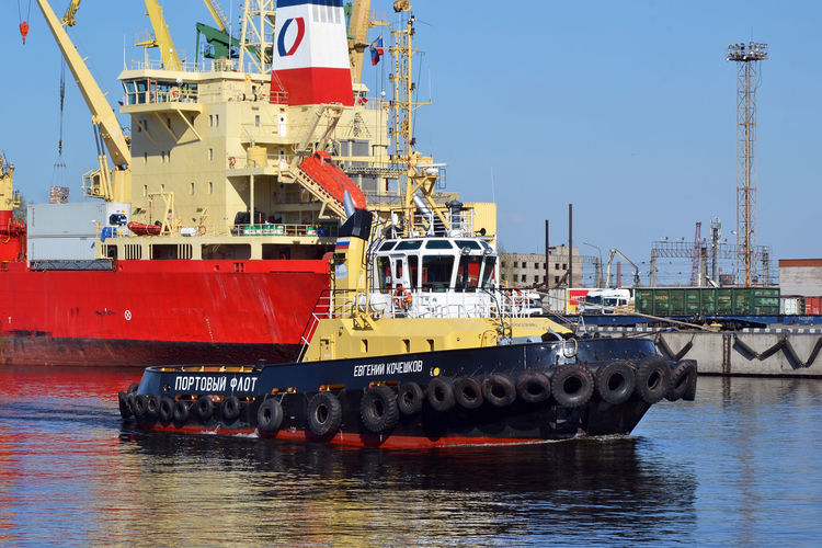 """Maritime canal (""""Morskoy Kanal""""), Saint Petersburg, Russia Morskoy Kanal Crane - Construction Machinery Day Harbor Industry Maritime Canal Mode Of Transport Nautical Vessel No People Outdoors Russia Saint Petersburg Sea Ship Shipping  Sky Transportation Water Waterfront EyeEm Selects"""