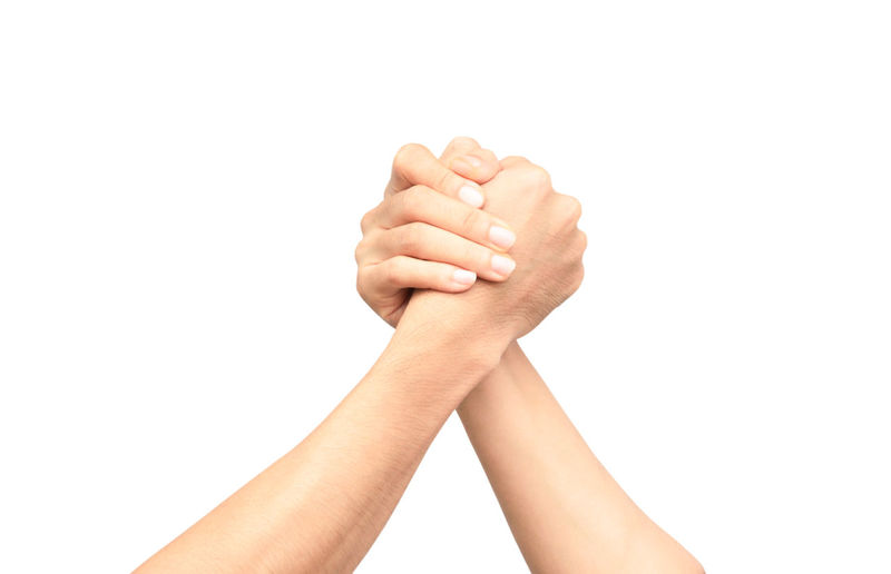 Man and woman shaking hands, isolated on white background Hands Man Team; Gorgeouss Teamwork Achievement; Agreement Background; Business; Businessman; Concept; Congratulating; Connection Cooperation Handshake Isolated; Partnership; People Power; Shake Success Togetherness Two; Unity; White Woman;s Shoes