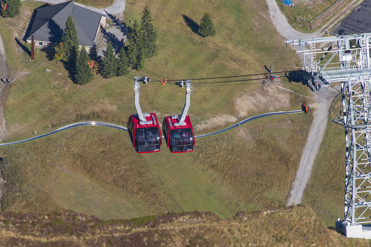 High angle view of overhead cable car on field