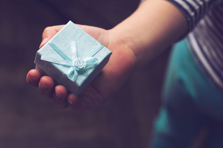 here you go dad Blue Child Childhood Gifts Hand Here You Go :) Holding Kids Kids Being Kids Small