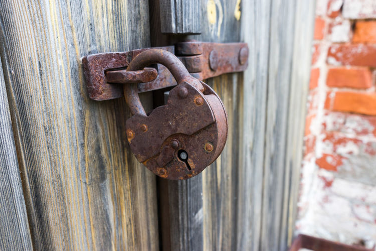 Old Lock Close-up Closed Day Decline Deterioration Door Entrance Latch Lock Metal No People Old Outdoors Padlock Protection Run-down Rusted Rusted Lock Rusty Safety Security Weathered Wood - Material