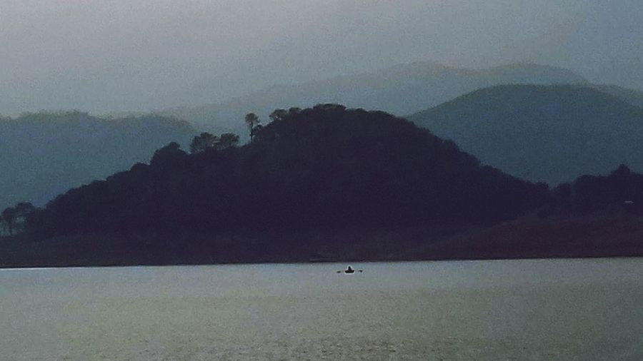 The bliss of solitude.. Hills, Mountains, Sky, Clouds, Sun, River, Limpid, Blue, Earth Silhouette Outdoors Water Fog Beauty In Nature Nature