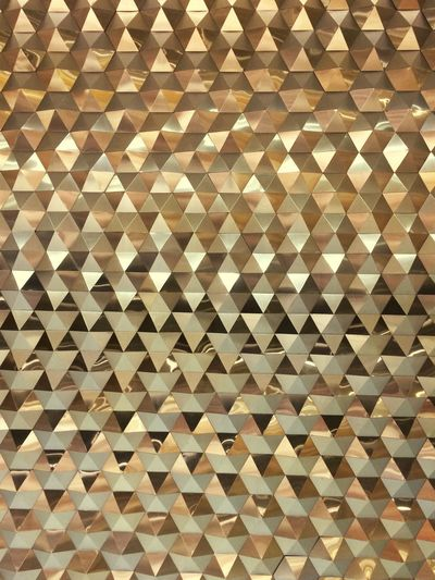 Gold Reflection Ornament Wall - Building Feature Full Frame Backgrounds Pattern Indoors  No People Design Shape Textured  Art And Craft Flooring Repetition Close-up Geometric Shape Large Group Of Objects Shiny Gold Colored Diamond Shaped