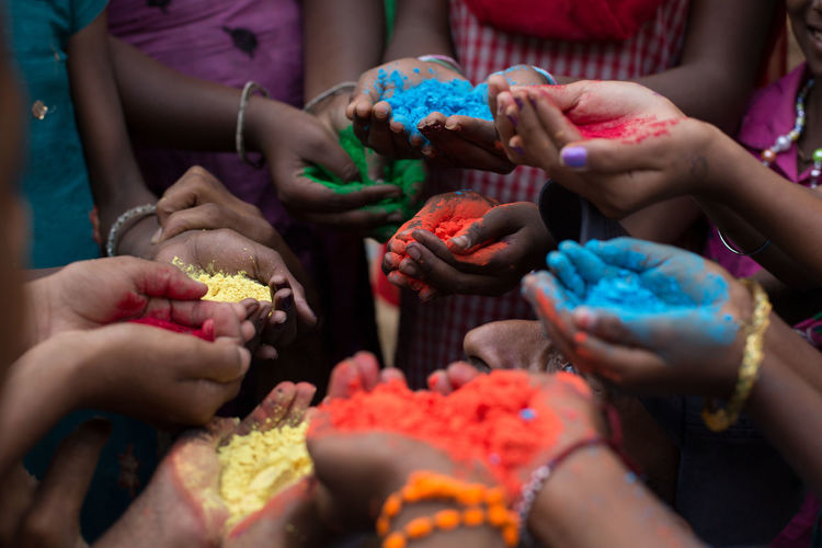 Color Powder On Hands During Holi Festival