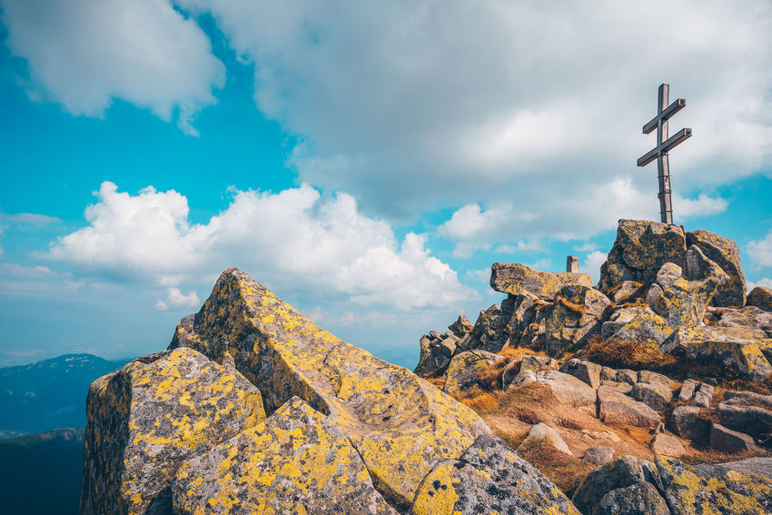 Dumbier peak. Double cross on a highest point of Low Tatras Cross Double Cross Dumbier Tatra Mountains Architecture Beauty In Nature Belief Built Structure Cloud - Sky Cross Day Low Angle View Low Tatras Mountain Nature No People Outdoors Religion Rock Rock - Object Scenics - Nature Sky Solid Spirituality Symbol The Traveler - 2018 EyeEm Awards