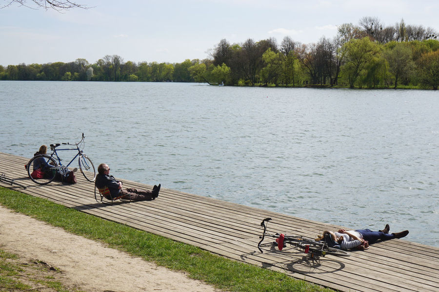 Bicycle Bike Boardwalk Cyclist Day Enjoying Life Enjoying The Sun Lake Leisure Activity Lifestyles Maschsee Nature Outdoors People Real People Recreation  Relaxing Sitting Spring Taking A Break Tranquility Water