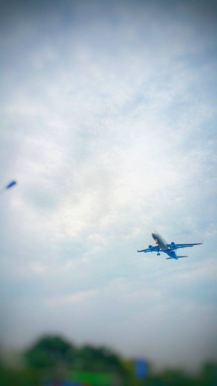 airplane, flying, transportation, sky, air vehicle, low angle view, journey, mid-air, travel, cloud - sky, mode of transport, outdoors, day, no people, nature, airshow