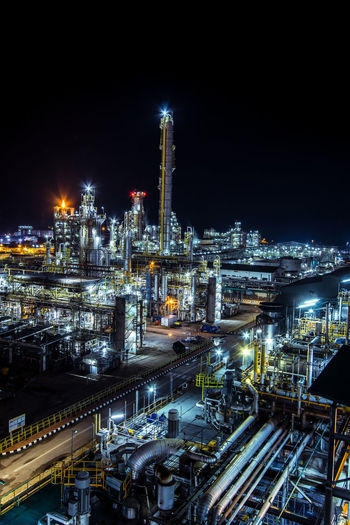 High angle view of illuminated factory at night
