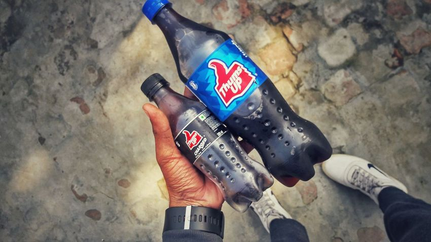 plastic bottles End Plastic Pollution One Person Human Body Part Human Hand Real People Hand Holding Body Part Wall - Building Feature Personal Perspective Low Section Lifestyles Patriotism Sport Leisure Activity Shoe Midsection Adult Standing Flag Human Limb