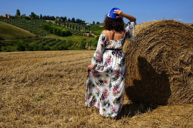 Beautiful woman between round bales