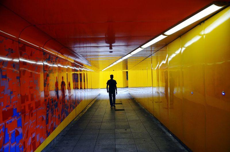 Rear view of man at subway station
