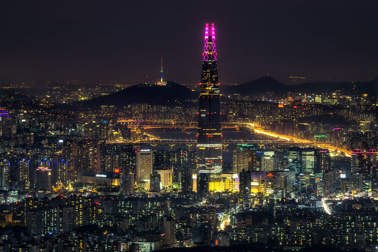 Night view over Seoul taken from Namhansanseong fortress. The view of Lotte tower lit up with the han river and namsan tower in the background Han River Korea Korean Seoul Travel Architecture Building Building Exterior Built Structure City Cityscape Crowd Crowded Illuminated Lotte Tower Nature Night Office Building Exterior Outdoors Sky Skyscraper Spire  Tall - High Tower Travel Destinations Adventures In The City Capture Tomorrow