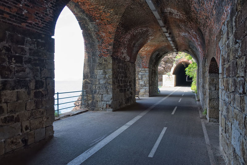 Tunnels between Bonassola and Framura - Liguria - Italy Bench Bonassola Formation Path Railing Rock Arch Arched Architecture Built Structure Day Direction Empty Framura Gallery History Liguria No People Pedestrian The Past The Way Forward Train Tunnel Wall Wall - Building Feature