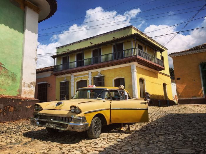 One cannot but enjoy the color coordination of the cars and houses here :-) Automobile Car Colorful Travel Photography Cuba City Street Walking Around The City  Architecture Cityscapes Walking Around IPhoneography Pastel Power Architectural Detail Clouds And Sky Eye4photography  Old Car Building Colors Exploring