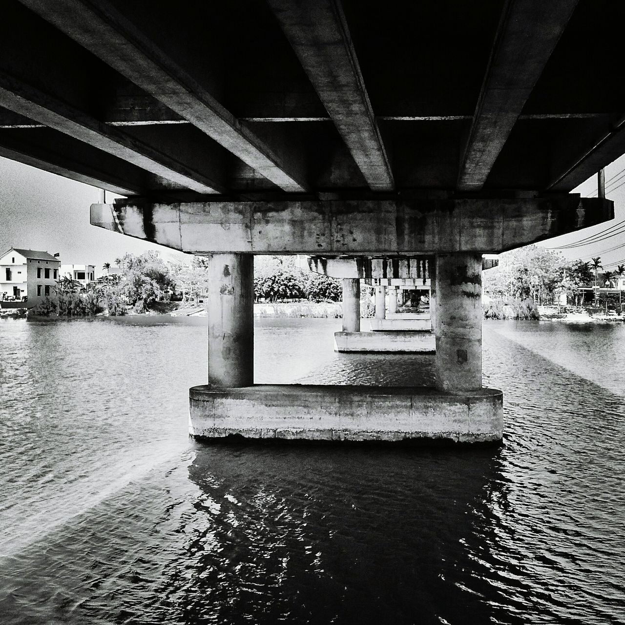 bridge - man made structure, connection, underneath, architecture, below, built structure, water, river, engineering, architectural column, transportation, bridge, under, covered bridge, day, outdoors, waterfront, nature, no people