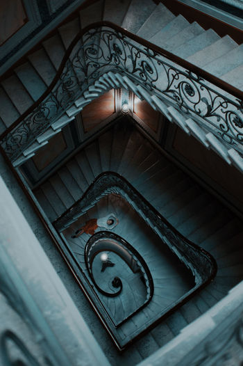 Low angle view of spiral staircase of old building