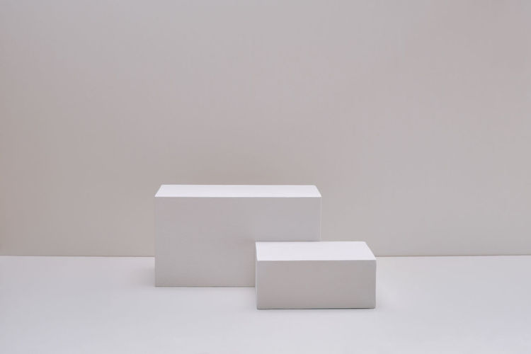 Empty white paper against wall