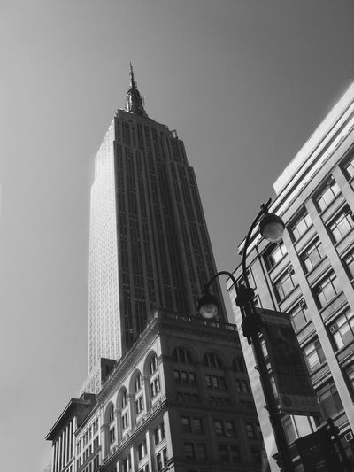 Low Angle View Of Empire State Building In City Against Clear Sky