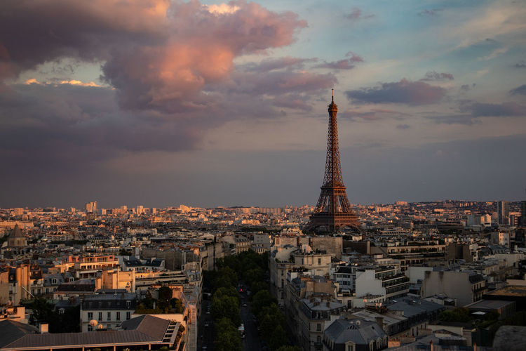 Eiffel Tower Arc De Triomphe Architecture Building Building Exterior Built Structure City Cityscape Cloud - Sky Crowd Crowded Nature Outdoors Residential District Sky Spire  Sunset Tall - High Tourism Tower Travel Travel Destinations