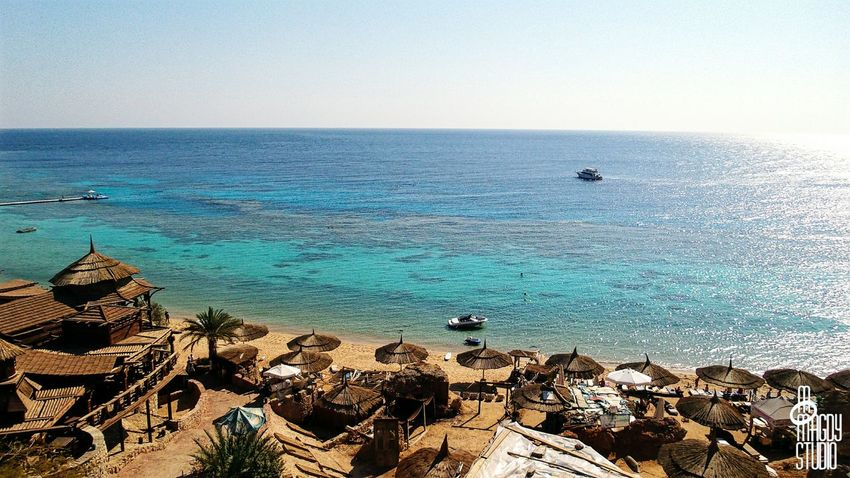 Sea Water Blue Boats Sky Koisk Umbrellas Seats Beach Sand Sun Tourism Sharm Sharmelsheikh RedSea Sharmissafe Southsinai Egypt Thisisegypt MoMagdyStudio