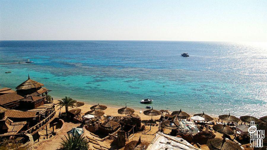 Sea Water Blue Boats Sky Koisk Umbrellas Seats Beach Sand Sun Tourism Sharm Sharmelsheikh RedSea Sharmissafe Southsinai Egypt Thisisegypt MoMagdyStudio