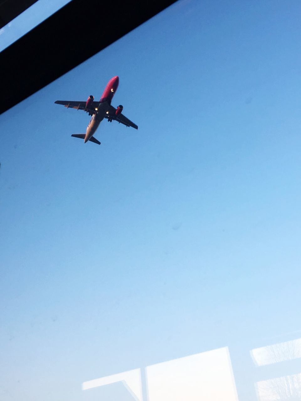 airplane, low angle view, flying, transportation, journey, clear sky, travel, air vehicle, day, mid-air, outdoors, blue, no people, sky