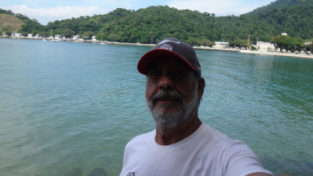 ANGRA DOS REIS ESCOLA NAVAL RIJ BRAZIL Cap Carefree Composition Day Escapism Front View Getting Away From It All Leisure Activity Lifestyles Looking At Camera Men Person Perspective Portrait Real People Recreational Pursuit Relaxation Sitting Weekend Activities Young Adult Young Men