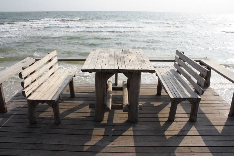 Absence Beauty In Nature Day Horizon Over Water Nature No People Outdoors Picnic Table Scenics Sea Shadow Sky Sunlight Table Water Wood - Material Wood Paneling
