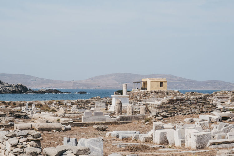 Ruins on the island of delos, greece, an archaeological site near mykonos in the cyclades.