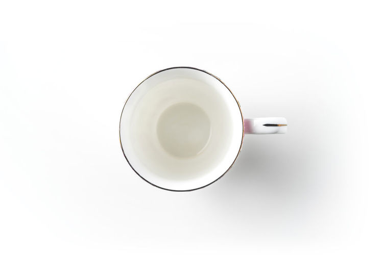 Directly above shot of coffee cup on white background