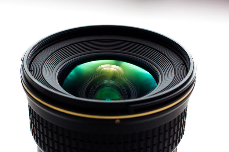 Close-Up Of Lens Over White Background