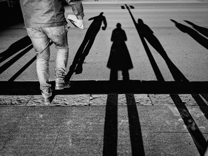 """""""Stepping off without looking. I wish I was that brave. Or stupid. Any one of the two."""" street photography People watching selfie ✌ bwphotography Long shad Street Photography People Watching Selfie ✌ Bwphotography Long Shadows Low Section Shadow Togetherness Human Leg Men Sunlight Walking Focus On Shadow Long Shadow - Shadow"""