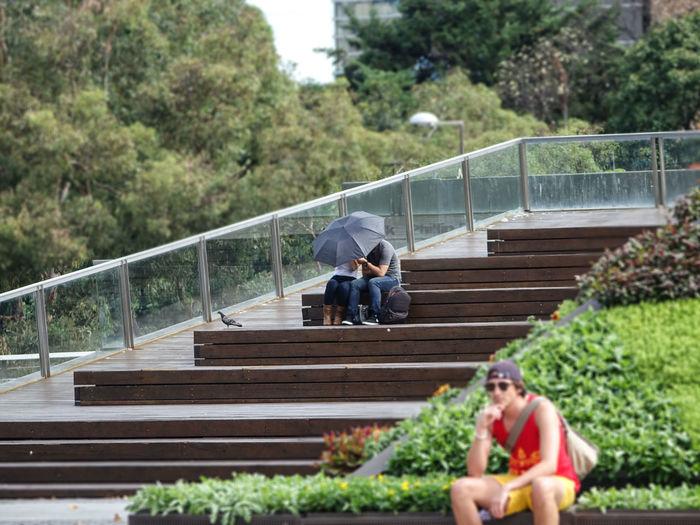 People on staircase by footbridge