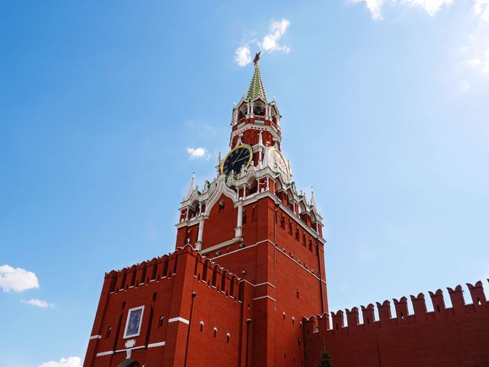 Low angle view of spasskaya tower against sky