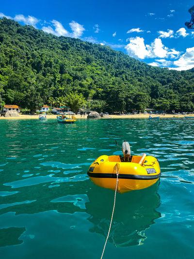 Yellow boat floating on lake