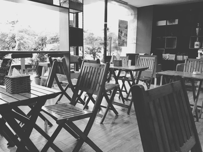 In a coffee shop Coffee Shop Chair Seat Table Absence Empty Business Architecture Day Restaurant Sunlight Indoors  No People Cafe Shadow Arrangement Furniture Built Structure Setting