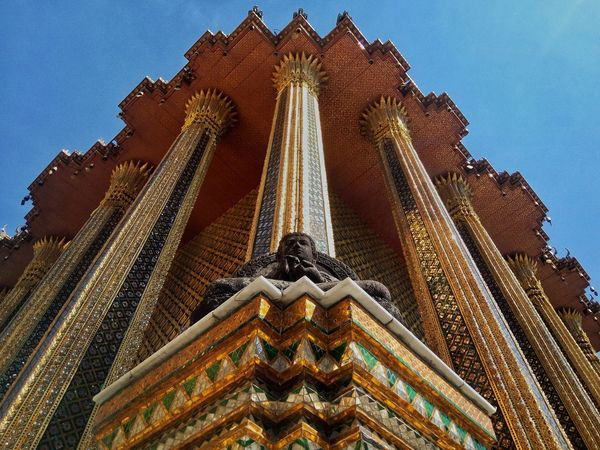 Stone Buddha Buddha Architecture Low Angle View No People Gold Colored Clear Sky Outdoors Place Of Worship Cultures Day Sky Wat Phra Kaew Bangkok Thailand ASIA Travel The Architect - 2017 EyeEm Awards Neighborhood Map