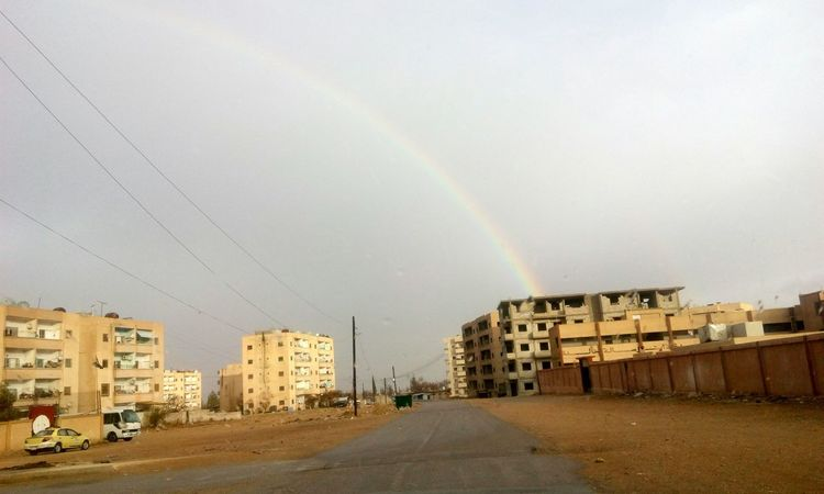 Nature . Rainbow . Sky . Rain