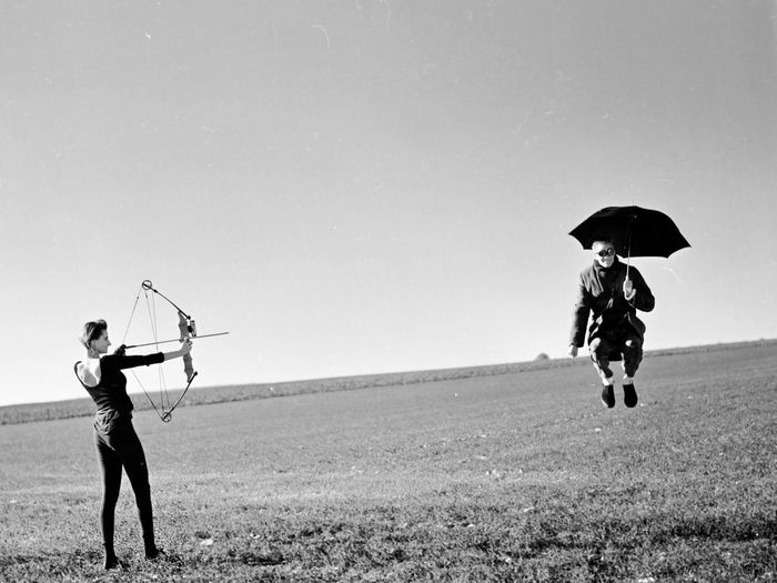 sometimes they come back Art Foto Couple Daydream Fine Art Photography Jump Archery Art Bow And Arrow Clear Sky Couple - Relationship Field Foto Art Holding Jumping Leisure Activity People Protection Real People Security Sky Staged Surreal Surrealism Two People Umbrella Go Higher