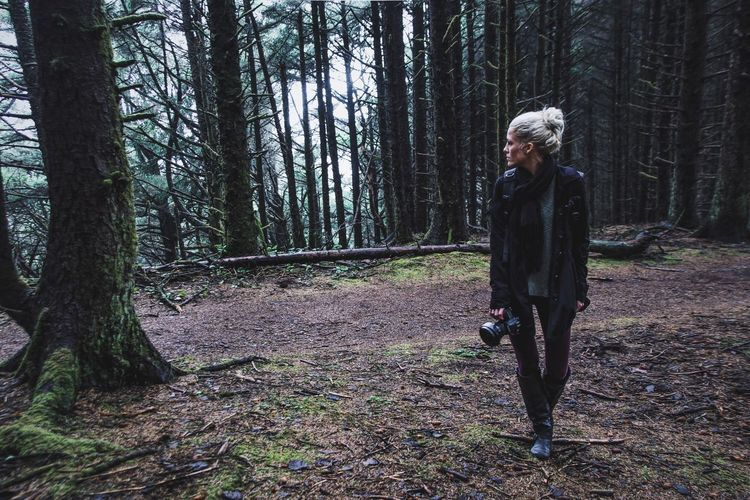 Mid Adult Woman Walking In Forest