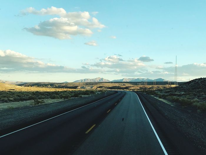 A view of the road ahead of us Travel Photography Travel Destinations Road Transportation The Way Forward Direction Sky Cloud - Sky Symbol City Day vanishing point Highway Car Diminishing Perspective Nature Sign Marking Road Marking