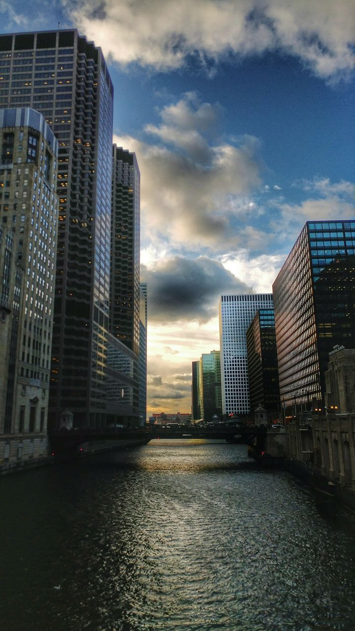 architecture, building exterior, city, built structure, skyscraper, sky, modern, waterfront, cloud - sky, river, no people, outdoors, water, cityscape, growth, tall, day, nature