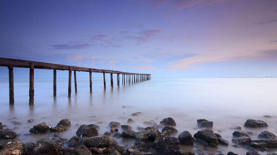 Old abandoned pier during sunset Architecture Beach Beauty In Nature Built Structure Cloud - Sky Cold Temperature Day Horizon Over Water Nature No People Outdoors Scenics Sea Sky Sunset Tranquil Scene Tranquility Water